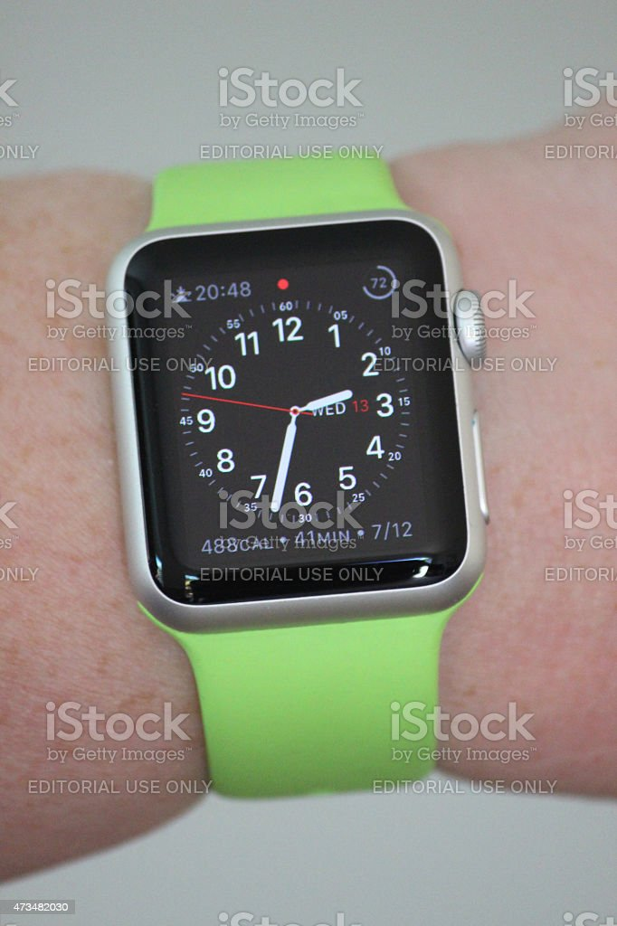 Image of Apple Watch Sport model, green strap, analogue clock-face stock photo