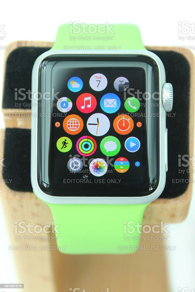 Image of Apple Watch 'Sport' model on wooden charging stand stock photo