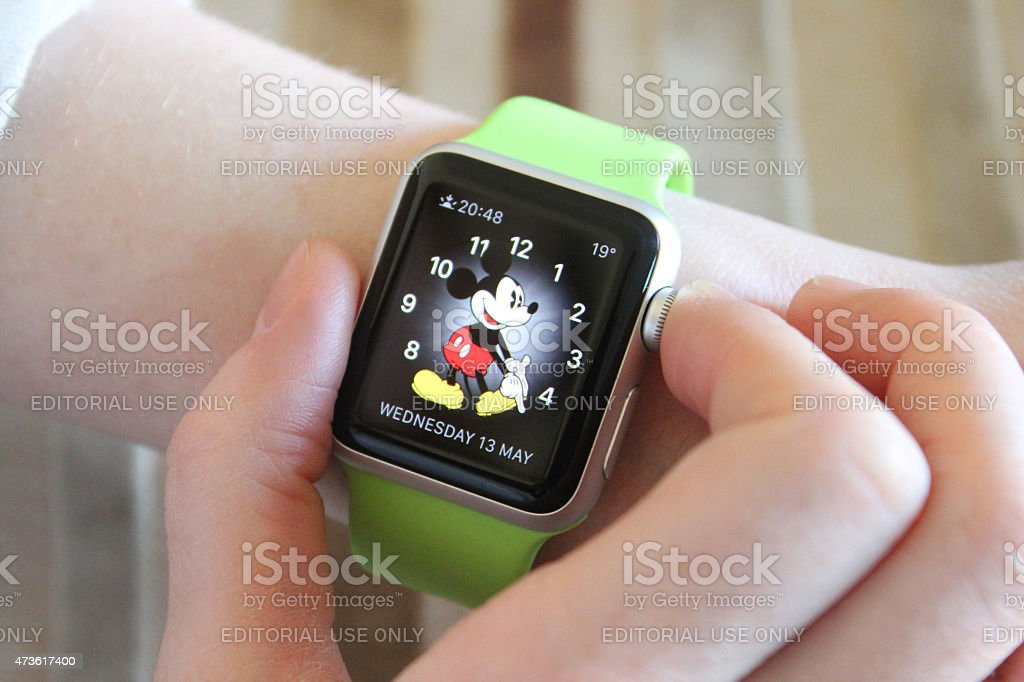 Image of Apple Watch Sport model with Mickey Mouse clock-face stock photo