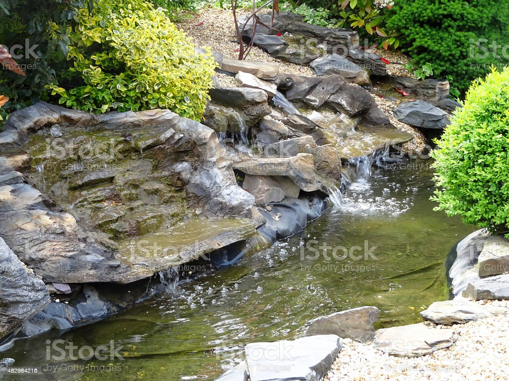 Image of artificial grey pond waterfalls made from plastic / fibreglass stock photo