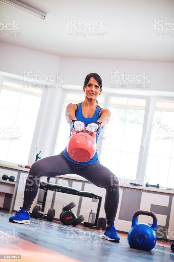 Image of athlete female with kettle bell weights zbiór zdjęć royalty-free