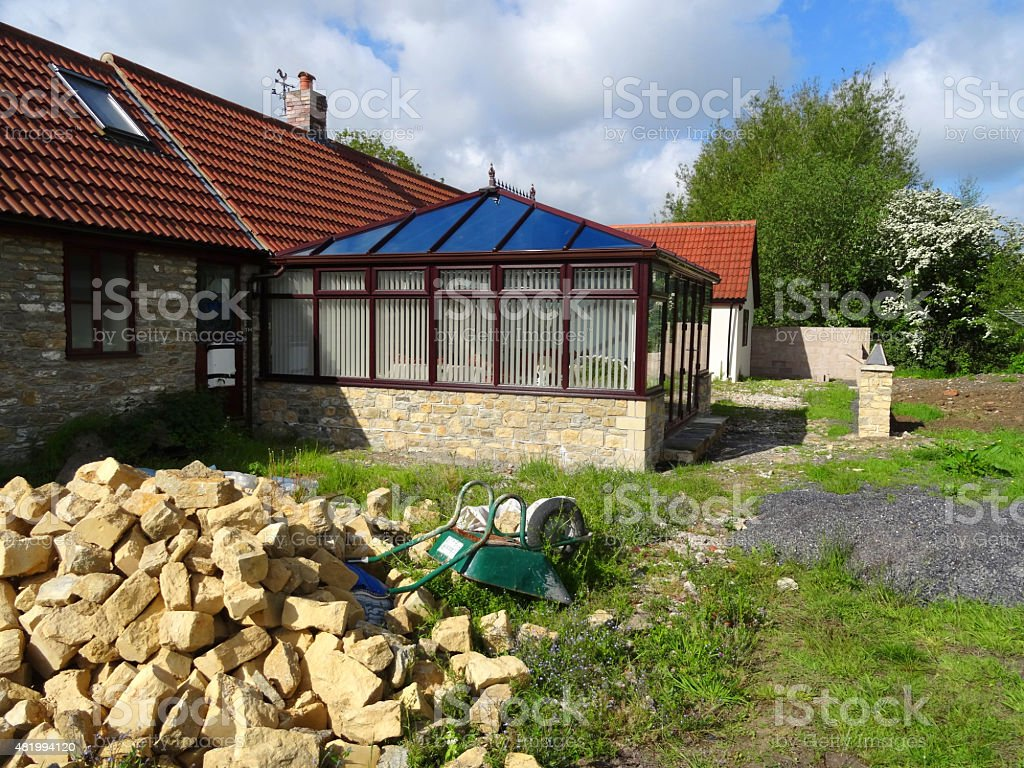 Image of barn conversion square conservatory with glass pyramid roof stock photo