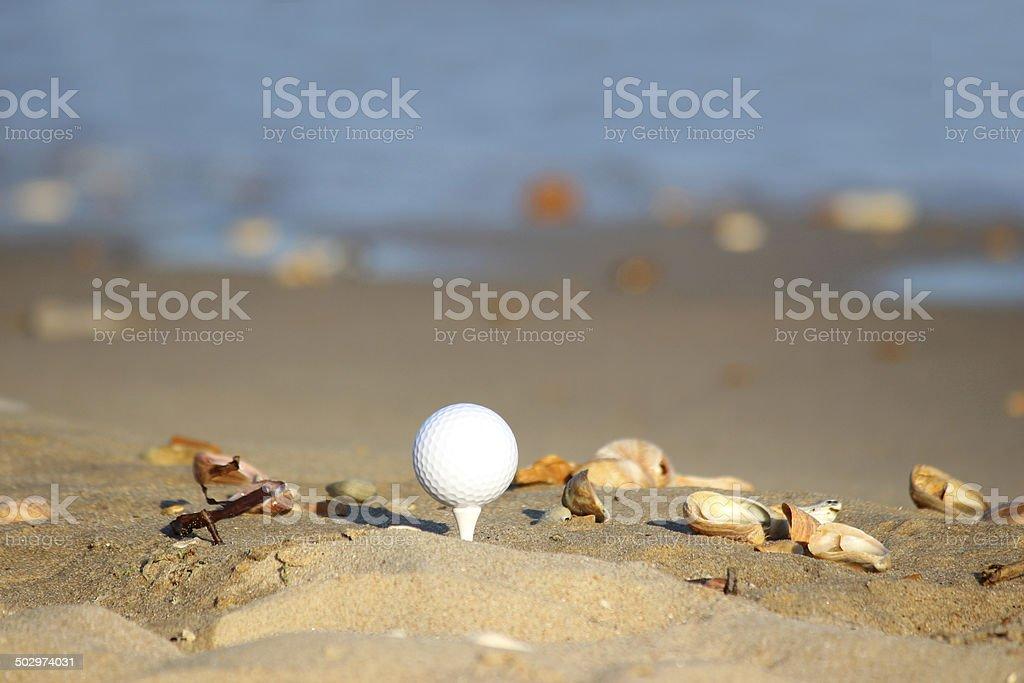 Image of beach golf / golf ball on sandy seaside beach royalty-free stock photo