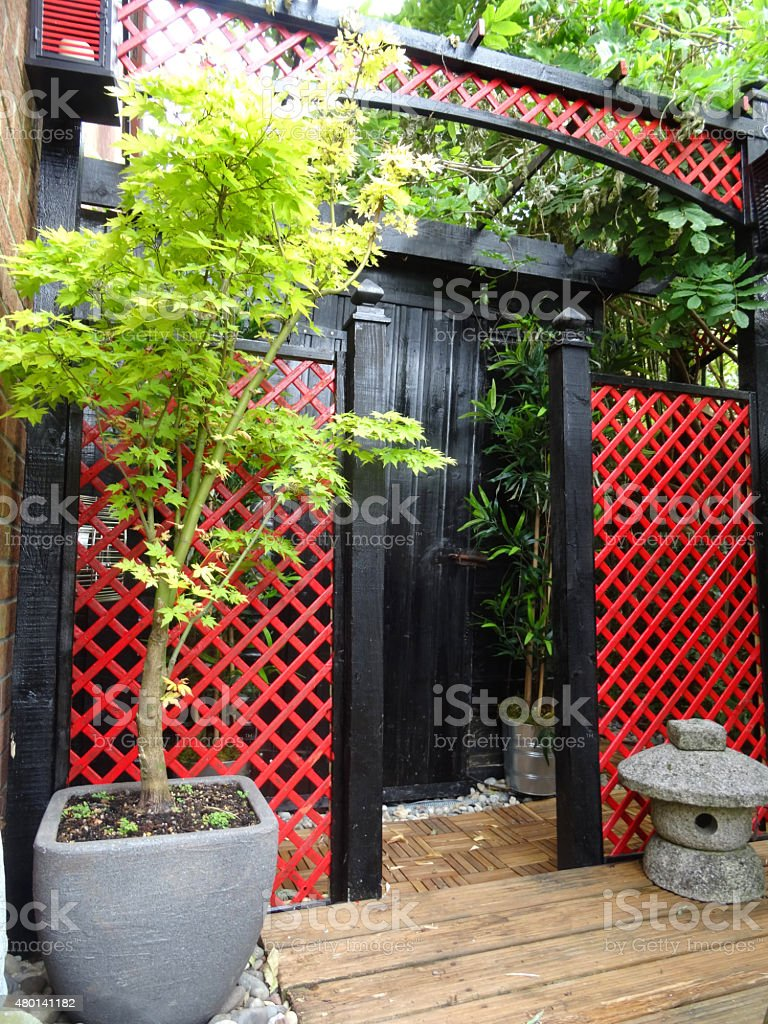 Image Of Black Garden Shed / Japanese Tea House / Red Trellis Royalty Free  Stock