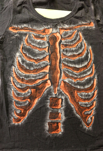 Image of black t-shirt with handcrafted, bleached, skeleton ribcaged design