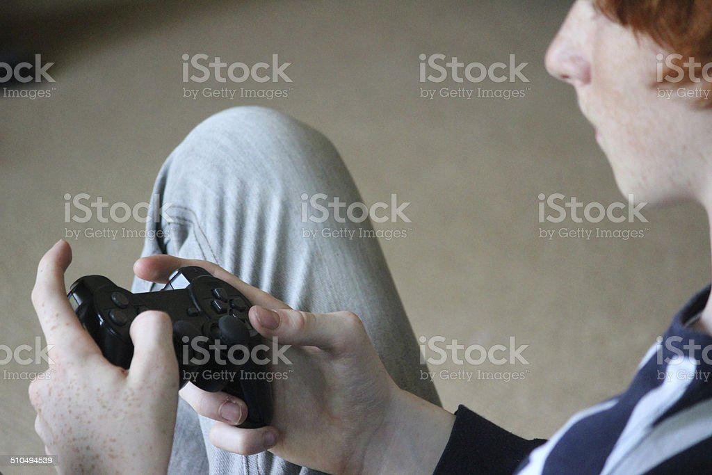 Image of boy playing computer game, gaming controller, video game stock photo