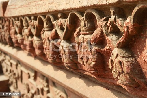 Stock photo of brick red Indian architectural detail at outside temple wall, sandstone ornamental stone carvings, ornate Mughal architecture frieze border photo, Agra Fort, Uttar Pradesh, India
