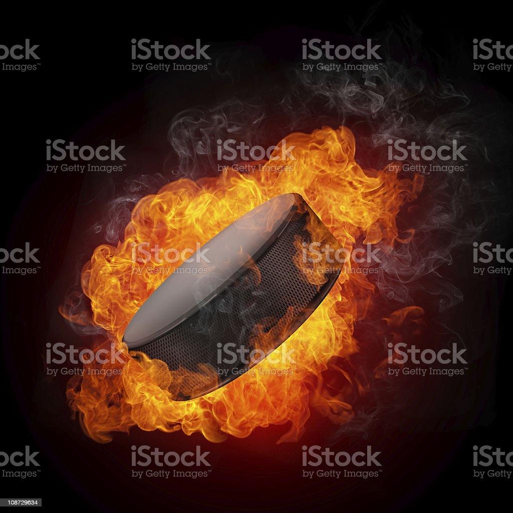 Image of burning hockey puck in the dark royalty-free stock photo