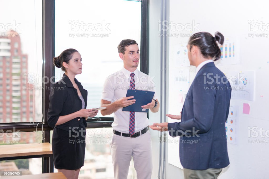 Image of business partners discussing documents and ideas at meeting Group of business people sharing their ideas. royalty-free stock photo