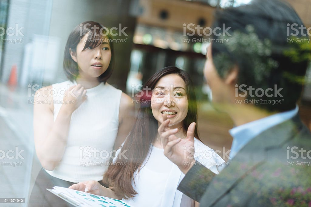 Image of business team in fruitful discussion on investment strategy stock photo