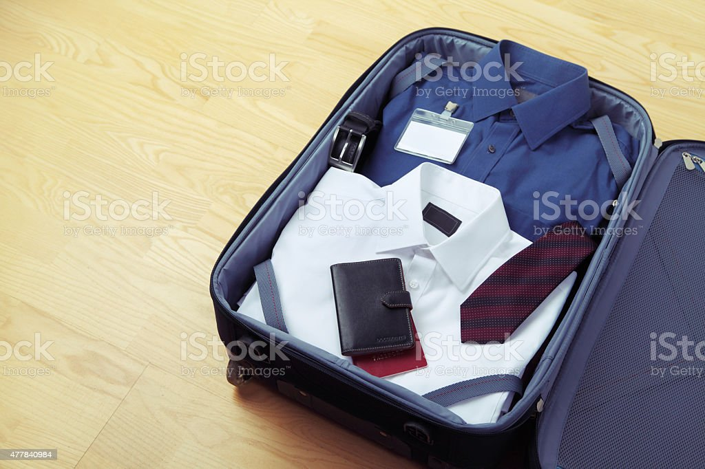 Image of businessman's clothes in travel bag stock photo