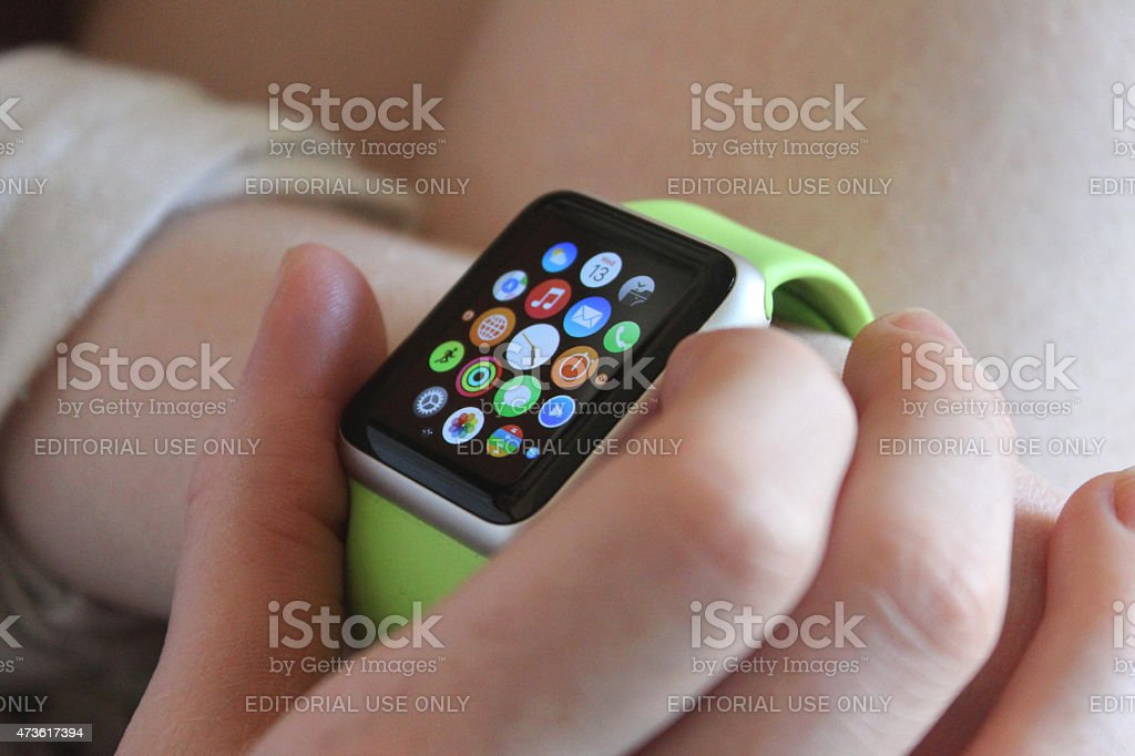 Image of buttons being pressed on Apple Watch apps screen stock photo