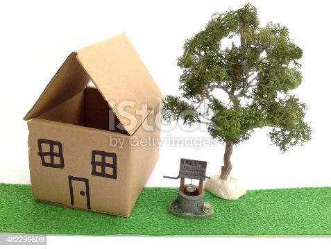 istock Image of cardboard dolls house, model wishing well and tree 482299809