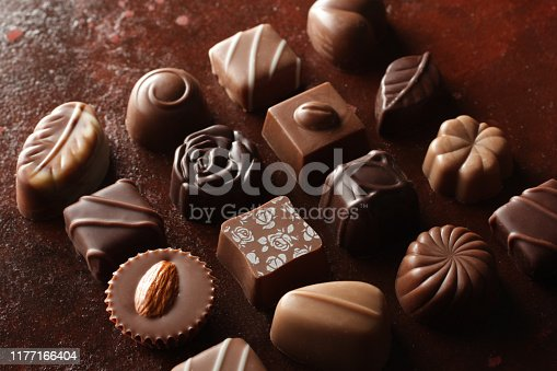 Various chocolates placed on various backgrounds, on paper, on antique background, blue, yellow background, English newspaper, etc.