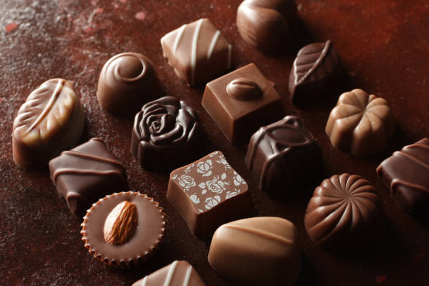 image of chocolate placed on various backgrounds - cioccolata foto e immagini stock