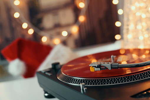Image Of Christmas Turntable Vinyl Record Player Sound Technology For Dj To  Mix Play Music Retro Audio Vinyl Record On A Background Of Christmas  Decorations Stock Photo - Download Image Now - iStock