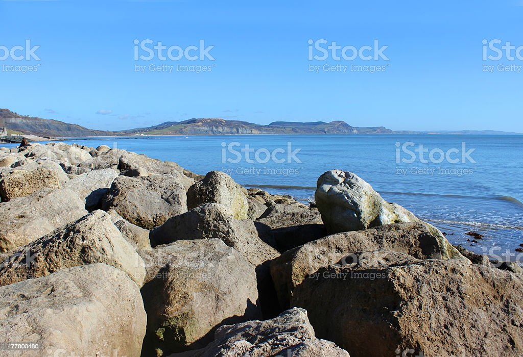 Image of coastal erosion management, riprap rock armour beach defence stock photo