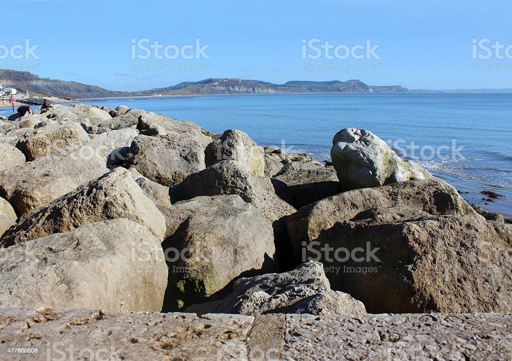 Image of coastal management with riprap rock armour sea defence stock photo