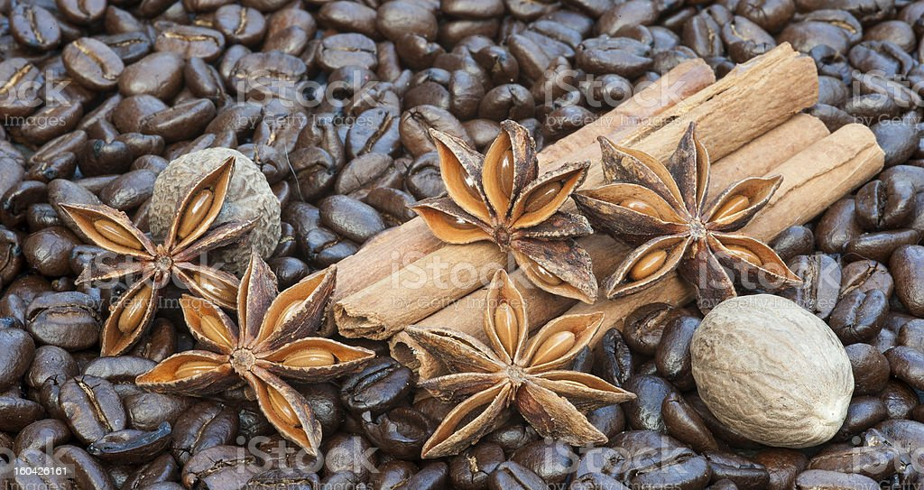 Image of coffee beans cinnamon sticks star anise nutmeg royalty-free stock photo