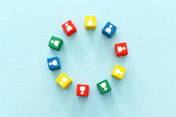 image of colorful blocks with people icons over wooden table ,human resources and management concept stock photo