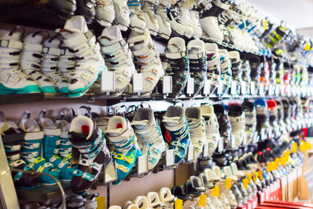 image of colorful ski boots on showcase - negozio sci foto e immagini stock