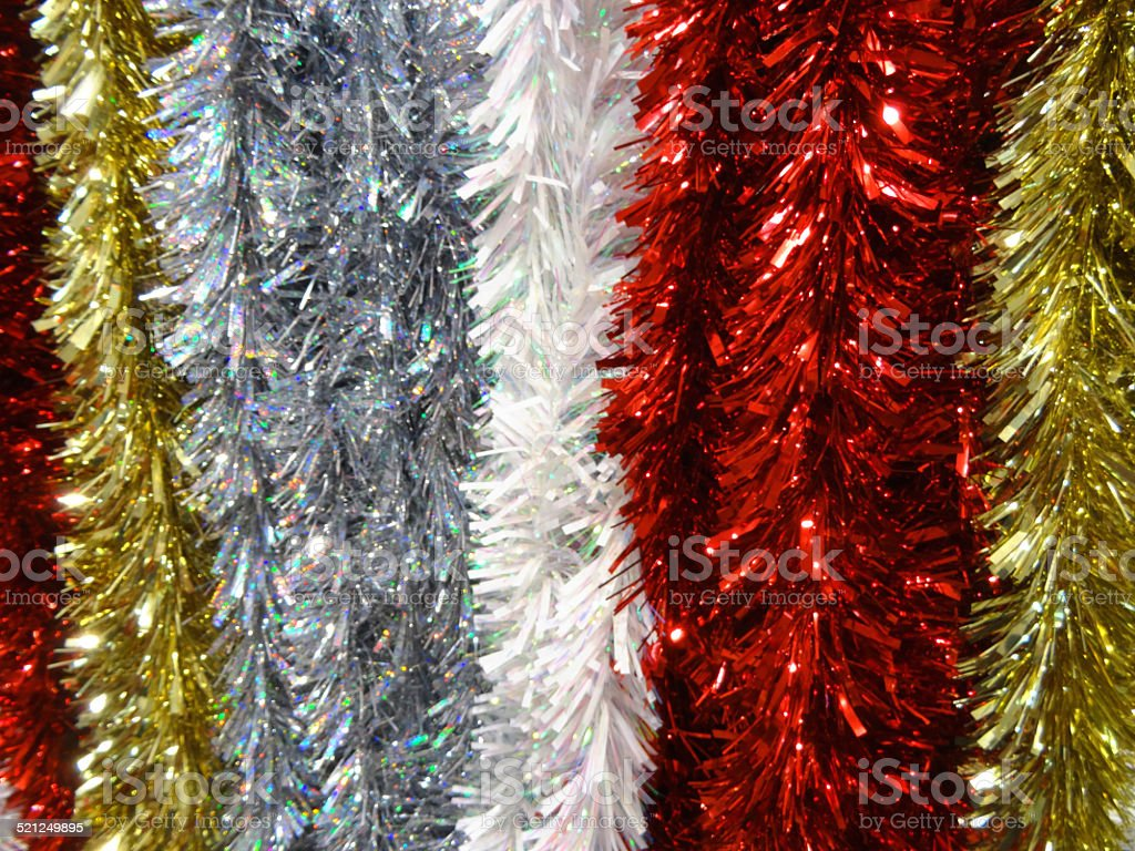 image of coloured tinsel christmas decorations red silver white gold royalty