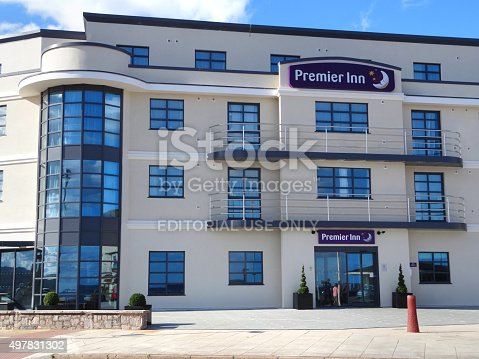 Exmouth, Devon, England, UK - July, 29 2015: Photo showing the curving contemporary architecture of the seafront Premier Inn Exmouth Hotel, which has a distinctive art deco appearance.