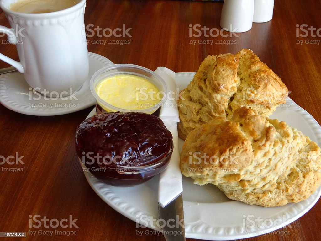 Image of cream tea with scones, strawberry jam, clotted cream stock photo