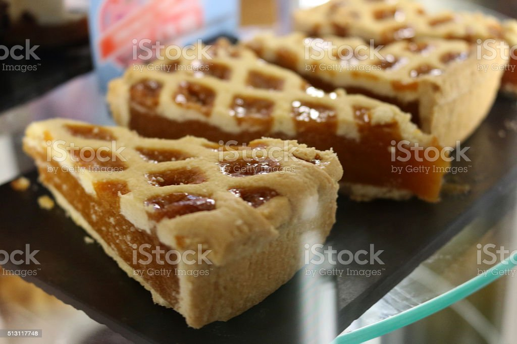 Image of display of ready-to-eat treacle tart slices awaiting selection stock photo