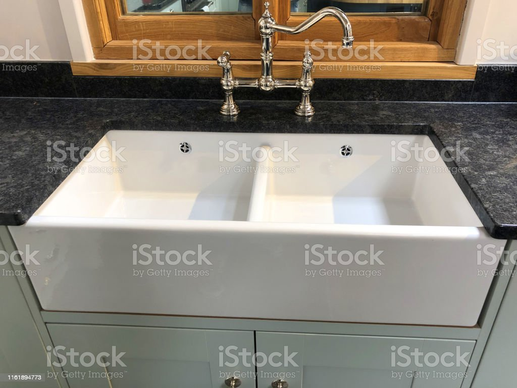 Stock Photo of double kitchen butler sink, white ceramic Belfast sink...