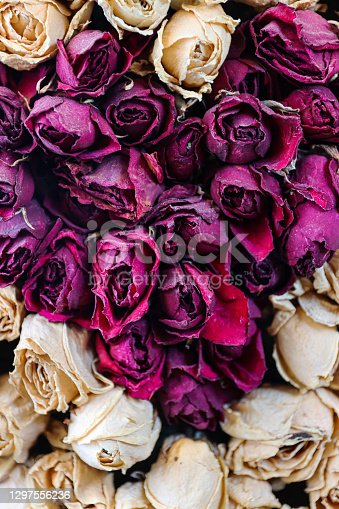Stock photo of dried red rose bouquet in a square with red rose arranged in heart shape surrounded with white rose flower, romantic floral arrangement for Valentine's Day love theme.