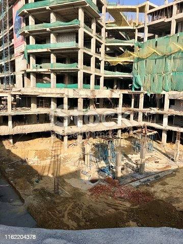 Stock photo showing a apartment tower block undergoing construction in India.