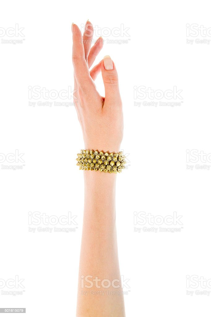 Image of female hand with a copper bracelet stock photo