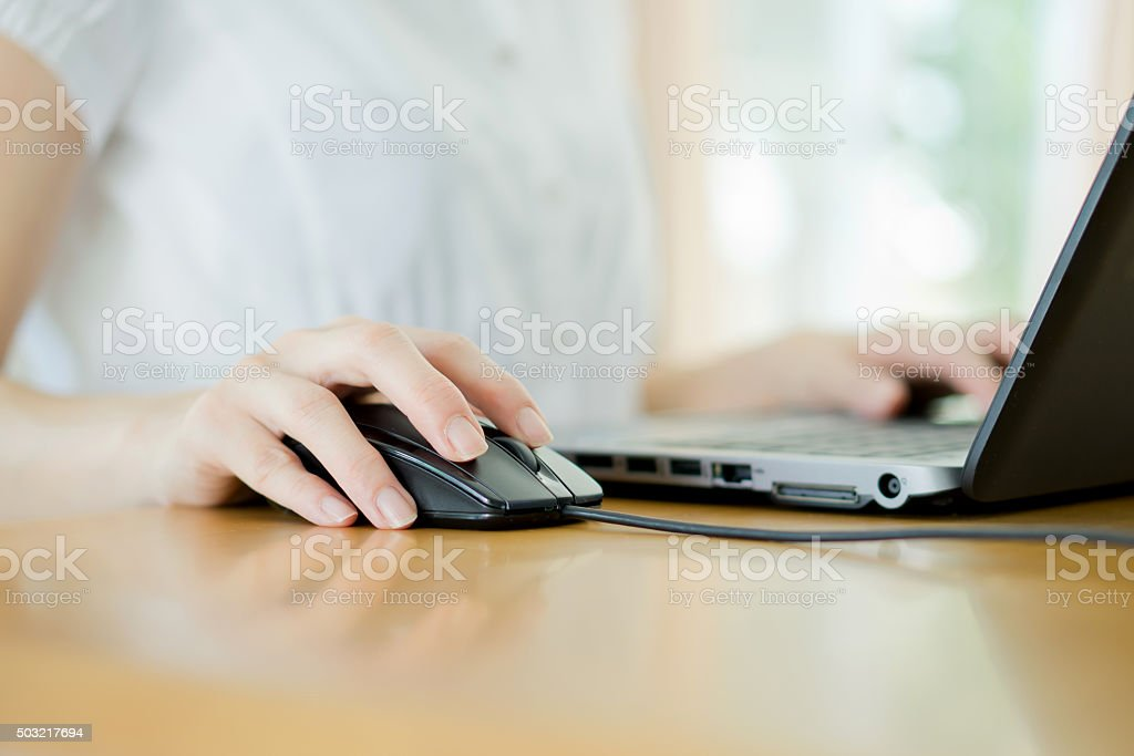 Image of female hands clicking computer mouse stock photo