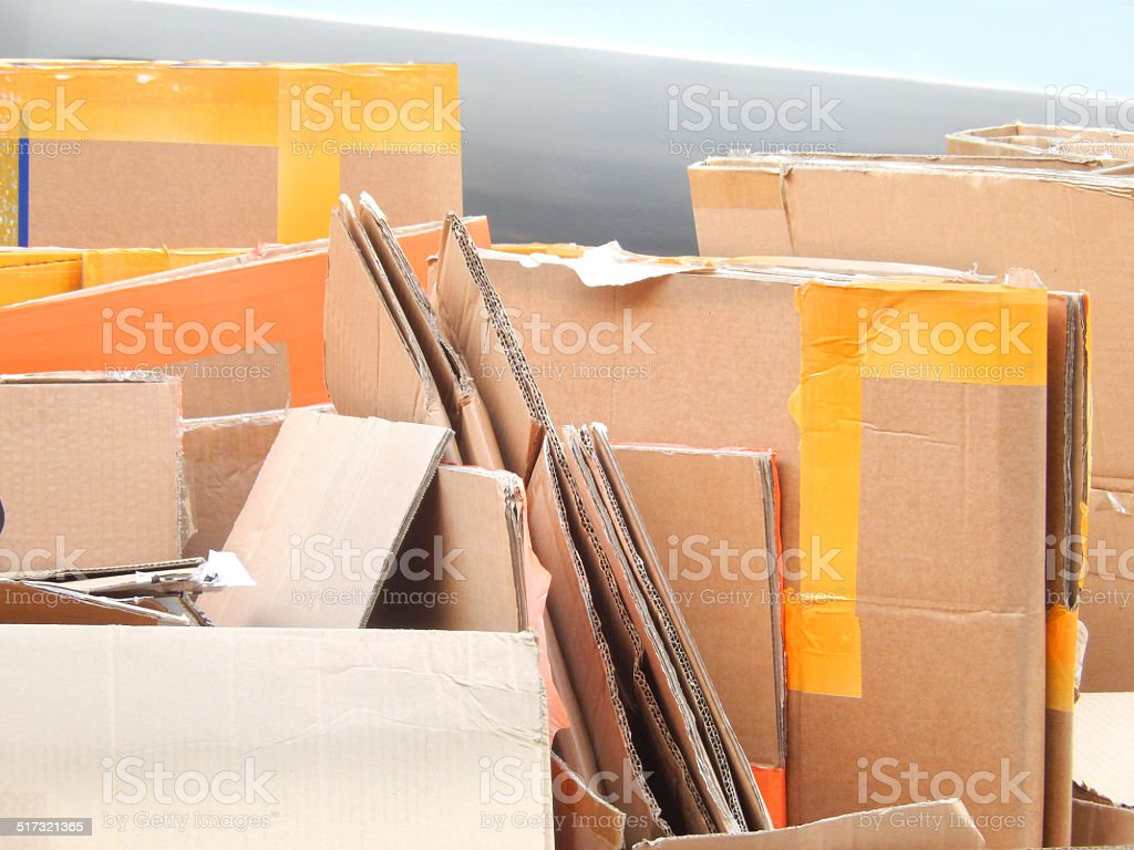 Image of flattened cardboard boxes being recycled / waste recycling plant stock photo