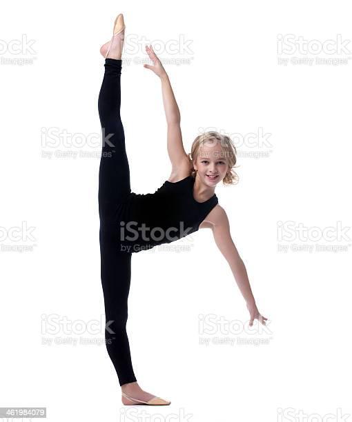 Flexible Little Girl Doing Vertical Split Stock Photo