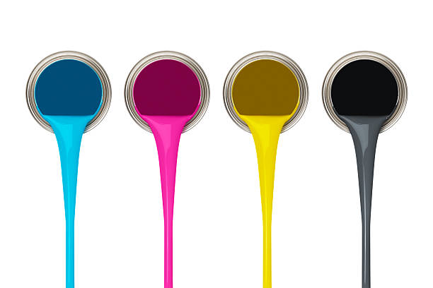 Image of four paint cans representing the CMYK color model pouring paints of CMYK colors from its buckets cmyk stock pictures, royalty-free photos & images