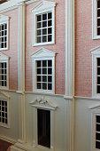 istock Image of front exterior of homemade toy dollshouse, red-bricks, window-panes 476118350