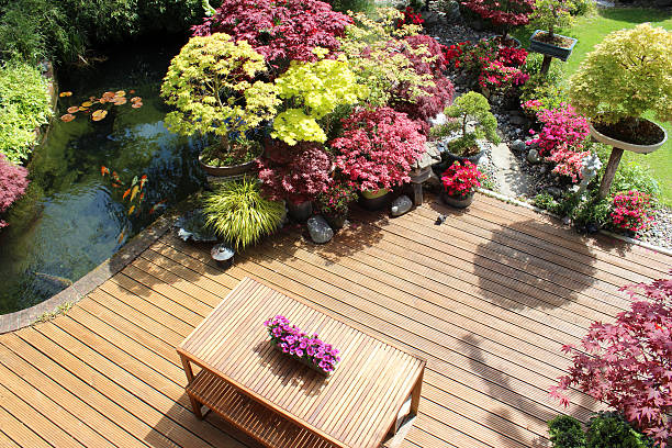 Image of garden decking from above, koi pond, Japanese maples stock photo