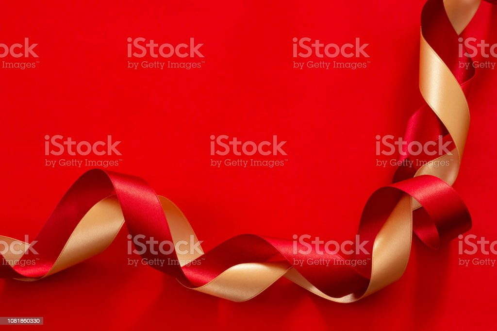 Image Of Gifts With Red Plain Background And Gold And Red