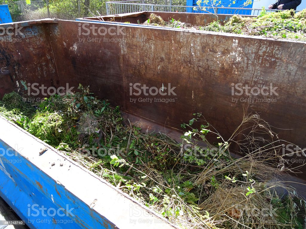 Image of green garden-waste skips at rubbish-dump / refuse recycling centre stock photo