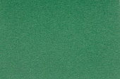 istock Image of green paper as a background. 1082405868