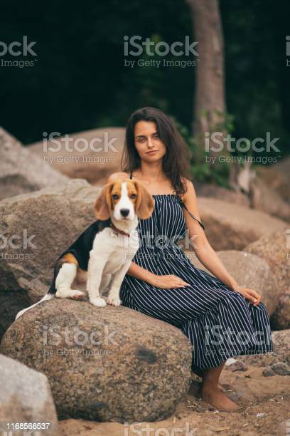 Image of happy woman 20s hugging her dog while walking along the picture id1168566537?b=1&k=6&m=1168566537&s=612x612&h=k3gp8xzbfils w0 dy7 dlp8uacovov a40qagtimau=