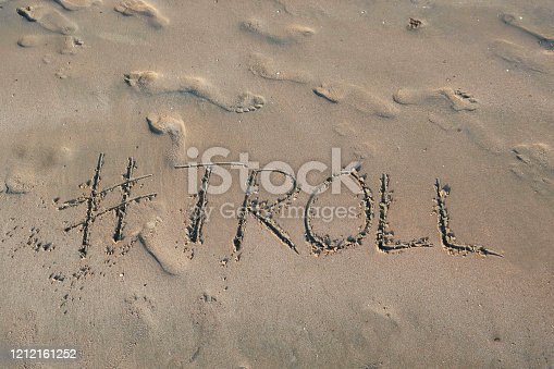 istock Image of hashtag tag writing on sunny beach with Troll word written in sand by sea, Palolem Beach, Goa, India, concept social media photo of handwriting in golden sand with modern hashtag prefiix 1212161252