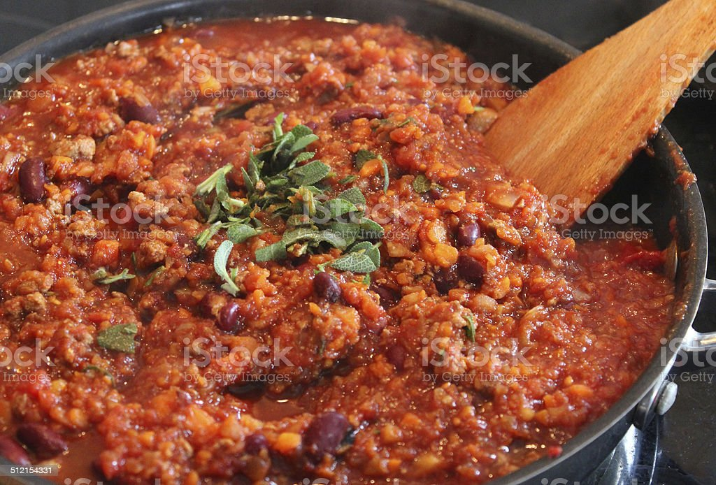 Image of healthy vegetarian chili con carne cooking, frying pan stock photo