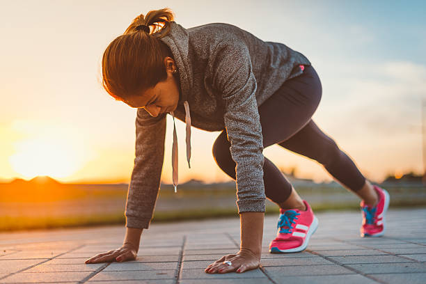 Image of healthy young recreational jogging woman stock photo