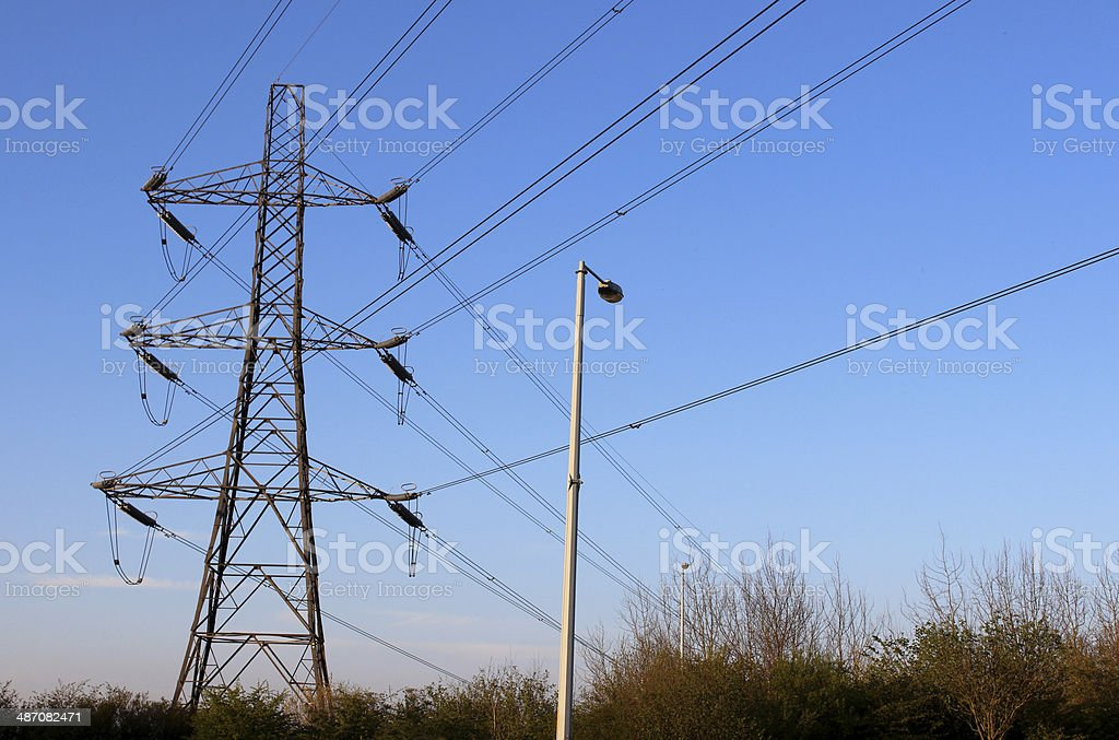 Photo showing a towering high voltage electricity pylon with lots of...