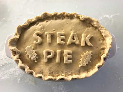 Image Of Homemade Steak Pie With Fresh Uncooked Pastry Cut ...
