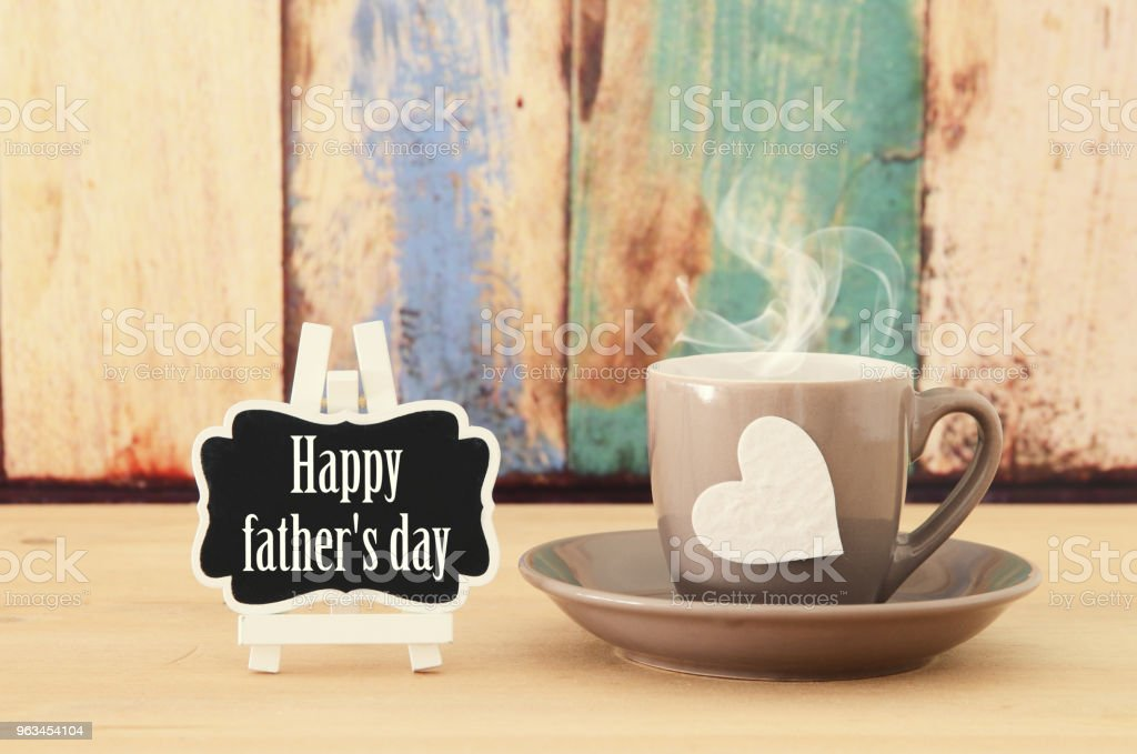 Image of hot coffee or tea over wooden table. Father's day concept. - Zbiór zdjęć royalty-free (Bez ludzi)