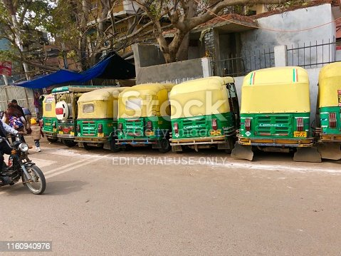 New Delhi, Uttar Pradesh, India - February 14, 2019: Auto rickshaws parked in a row awaiting passenger fares in New Delhi, Uttar Pradesh, India.